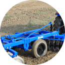 Hydraulically lifted center tyre for ease in transportation